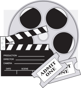Two Movie Tickets In Front Of A Take Clapperboard And A Reel Of Movie Film